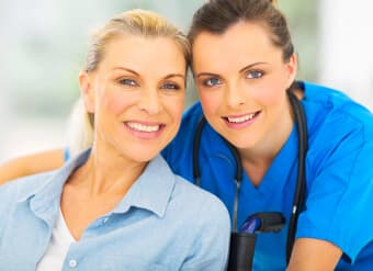caregiver and elder smiling