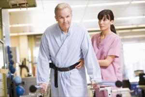 nurse assisting patient to walk